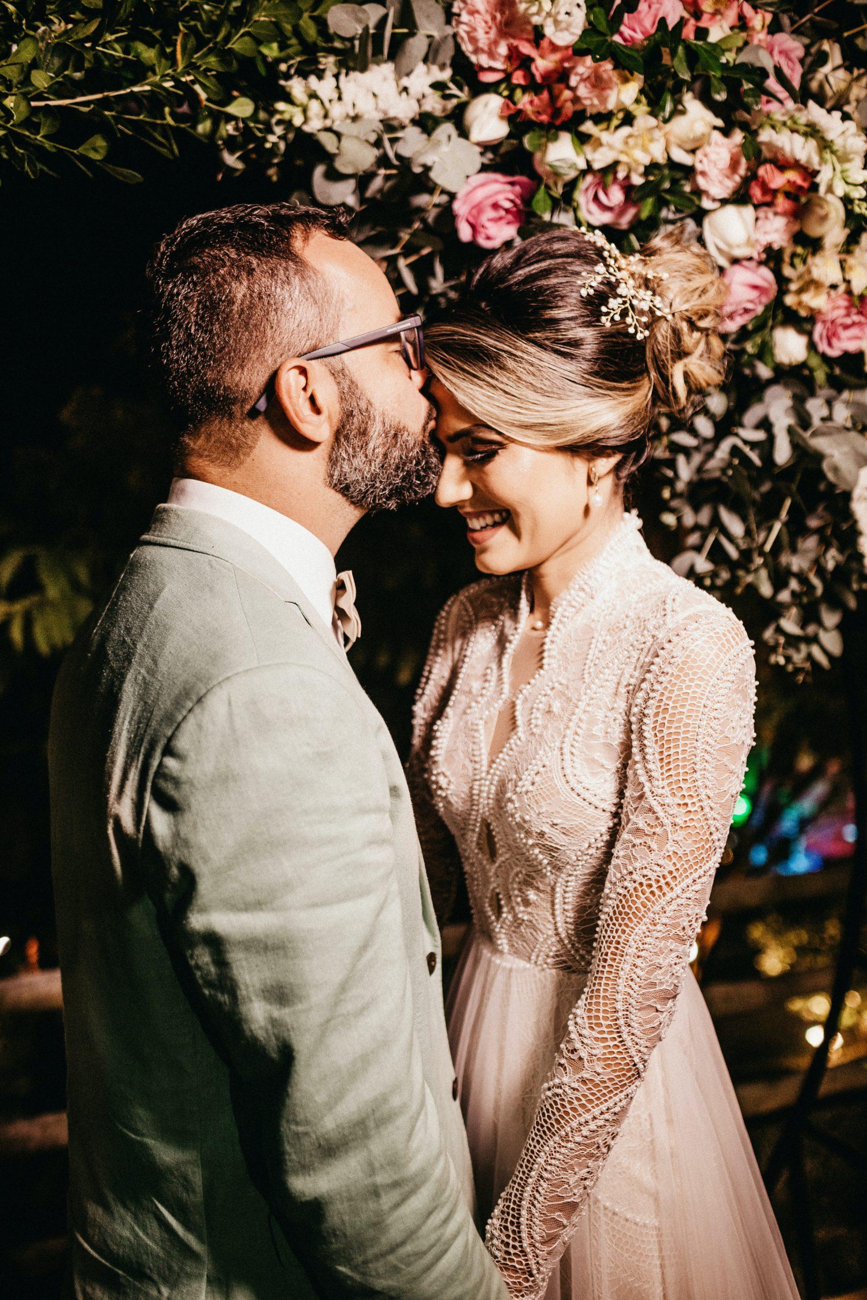 man-kissing-woman-forehead-3014857