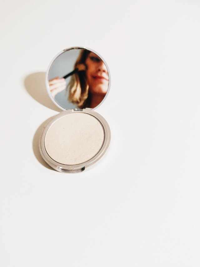 pressed-powder-on-white-surface-1499516