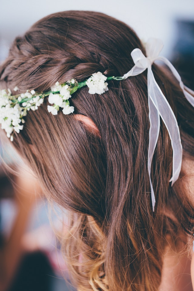 selective-focus-photo-of-woman-wearing-floral-headdress-1097222